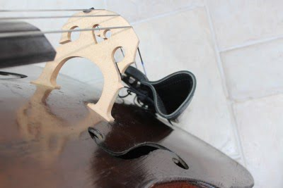 Players view of black leather double bass bow quiver