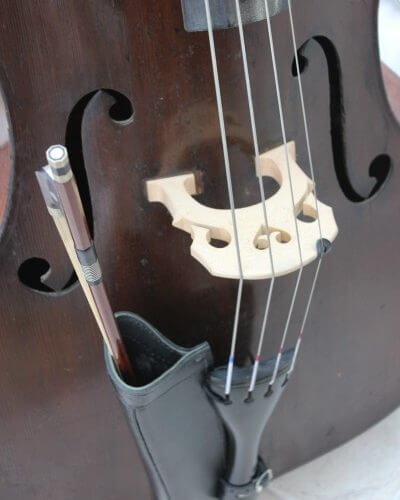 Black leather double bass bow quiver with bow insertedBlack leather double bass bow quiver with bow inserted