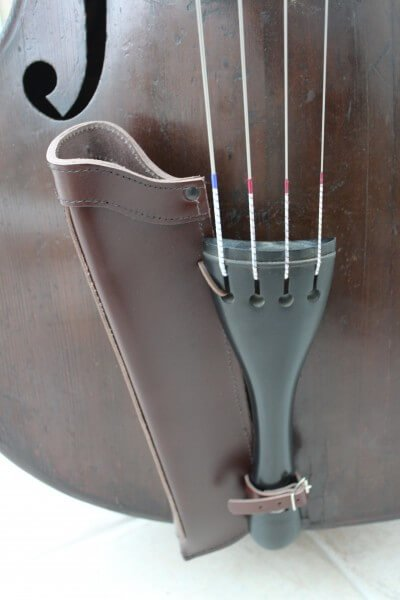 Close up of brown leather double bass bow quiver fitted