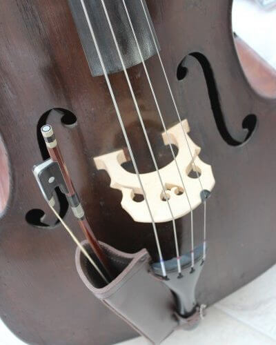 Brown leather double bass bow quiver with bow